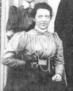 "Florence Campbell in 1898. Note the ""US"" belt buckle she is wearing. It appears to be a military belt buckle."